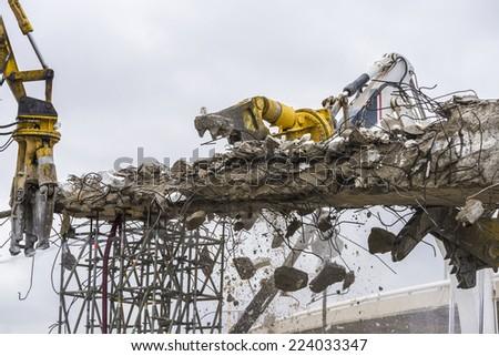 Three cranes breaking down a bridge en la plaza de Les Glories, Barcelona. - stock photo