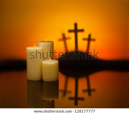 Three crosses symbolic for Jesus crucifixion in Golgotha and candles of hope - stock photo