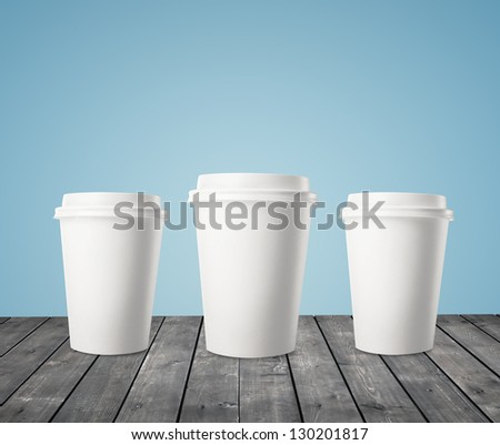 three cup of coffee on wood table - stock photo
