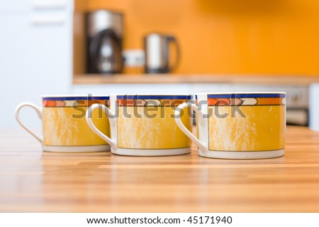 Three cups of tea close up shoot in the kitchen - stock photo