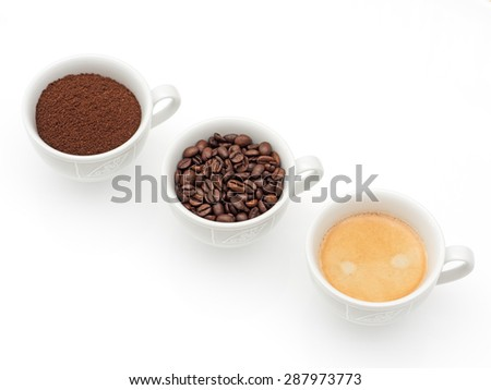 Three cups with coffee, coffee beans and ground coffee - stock photo