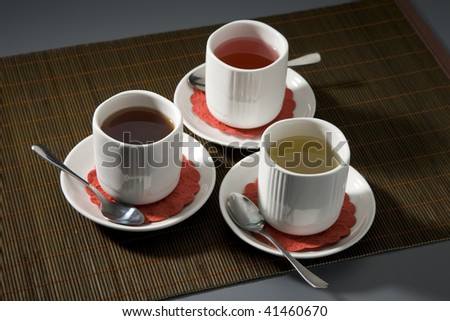 Three cups with different grades of tea - stock photo