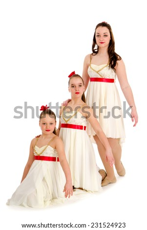 Three Dancers Perform as Sisters in Same Recital Costume - stock photo