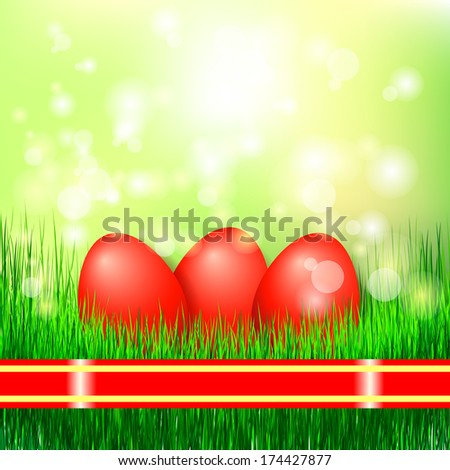 Three decorated easter eggs in the grass. Easter eggs on a fresh meadow.  - stock photo