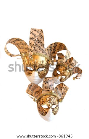 Three decorative carnival masks from Venice on a white background. - stock photo