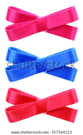 Three decorative ribbon bow ties pink red turquoise blue - stock photo