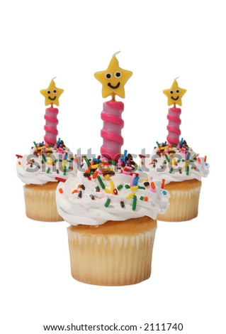 Three delicious cupcakes with funny star shaped candles - stock photo