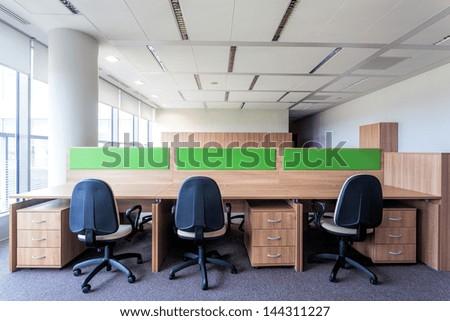 Three desks in the new contemporary office interior - stock photo
