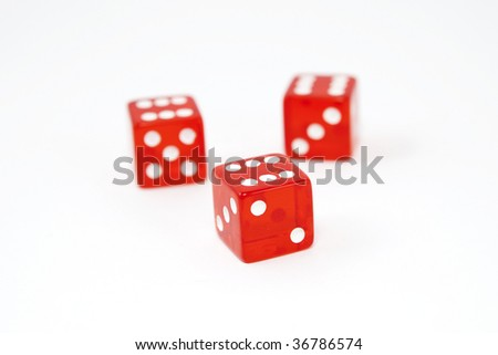 Three dice, all sixes, isolated on white background, shallow DOF - stock photo