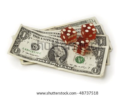Three dice and some dollar bills shown from a slight overhead angle on white background. Saved with clipping path - stock photo