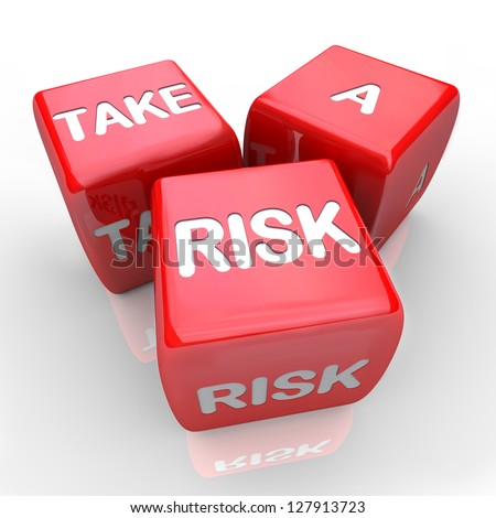 Three dice with the words Take a Risk - stock photo