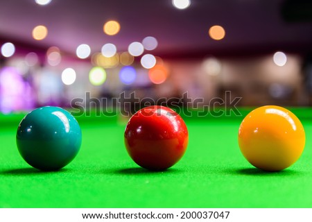 Three different colour snooker balls on the table - stock photo