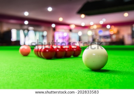 Three different colour snooker balls on the table. - stock photo