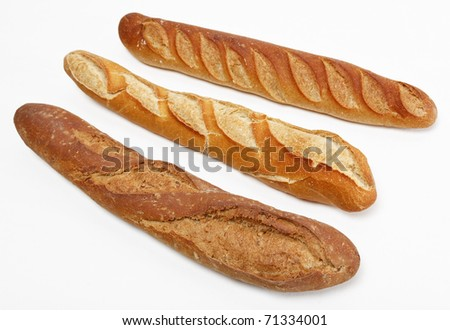 Three different French baguettes against a white background. - stock photo