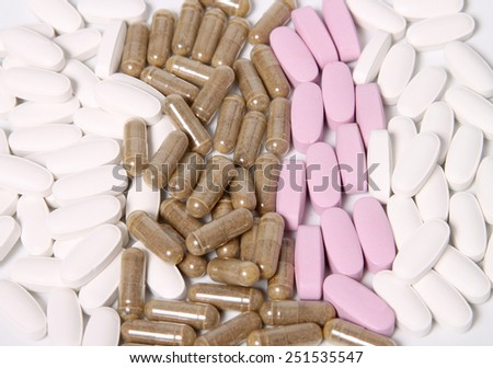 Three different kinds of vitamin and herbal supplement capsules - stock photo