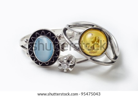 three different model and color rings stacked one over another - stock photo