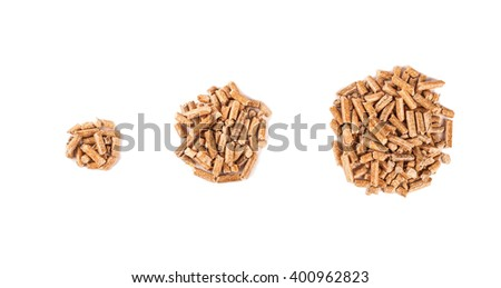 Three different piles of wood pellets isolated on white background - stock photo