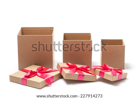 Three different sizes open carton gift boxes with red ribbons isolated on white  - stock photo