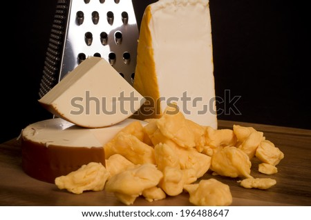 Three different types of cheese with the grater. - stock photo