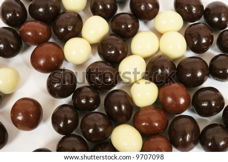 Three different types of chocolate candies. Abstract background - stock photo