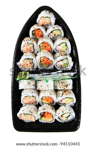 Three Different Varieties Of Japanese Sushi In A Sushi Boat Plastic Take Out Container - stock photo