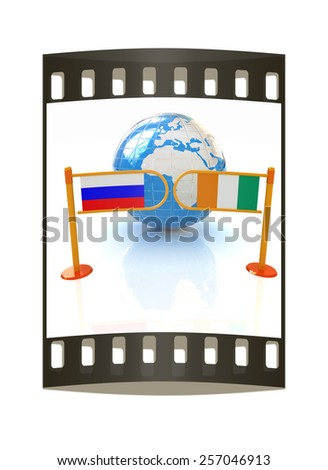 Three-dimensional image of the turnstile and flags of Ireland and Russia on a white background. The film strip - stock photo