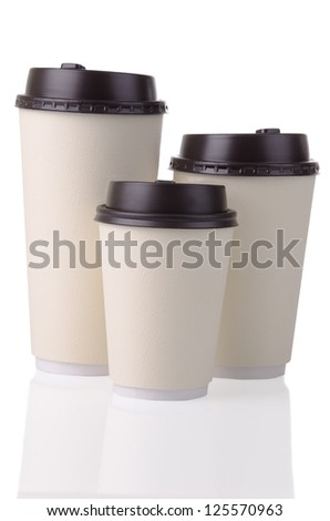 Three disposable coffee cups with plastic lid. - stock photo