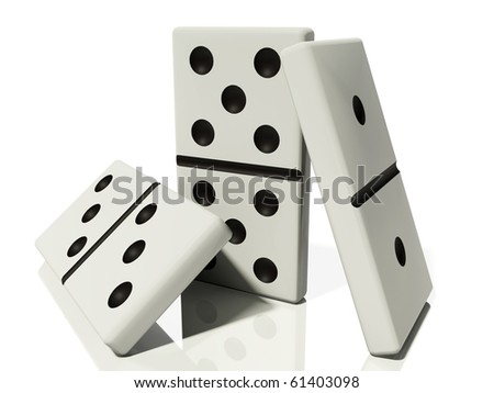 three dominoes in various poses are isolated on a white background with reflections and shadows - stock photo