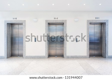 three doors in elevator - stock photo