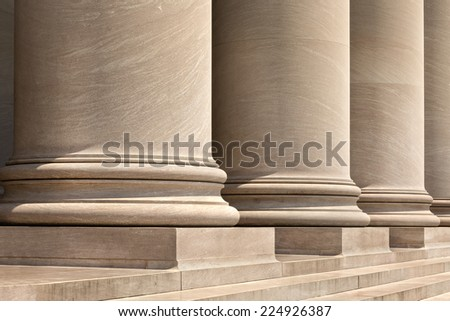 Three doric columns outside a courthouse. - stock photo