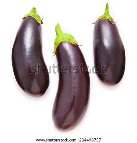 Three eggplants on white background - stock photo