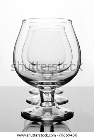 Three empty cognac glasses in a row - stock photo