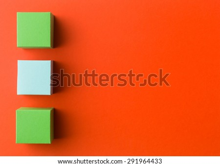 three empty colorful paper cubes in a row on red background. copy space available - stock photo
