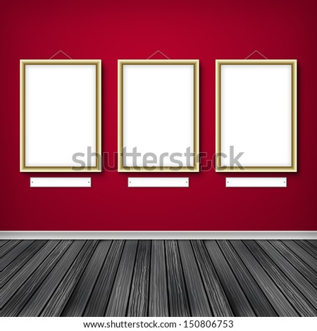 Three empty frames on a wall  - stock photo