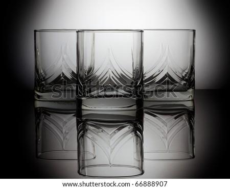 Three empty glass for whiskey - stock photo