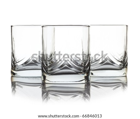 Three empty glass for whiskey over white background - stock photo