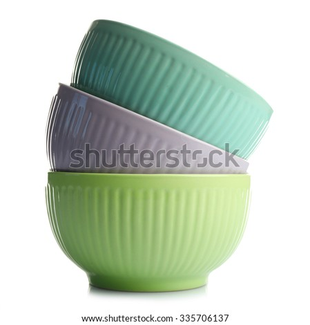Three empty stacked ceramic bowls, isolated on white - stock photo