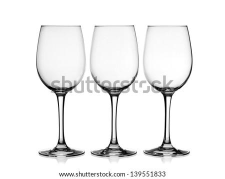 Three empty wine glasses - stock photo