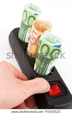 Three Euro banknotes in a black plug bar and a hand on the switch in front of a white background - stock photo