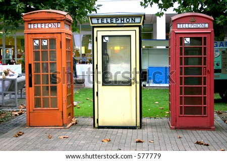 Three European telephone booths - stock photo