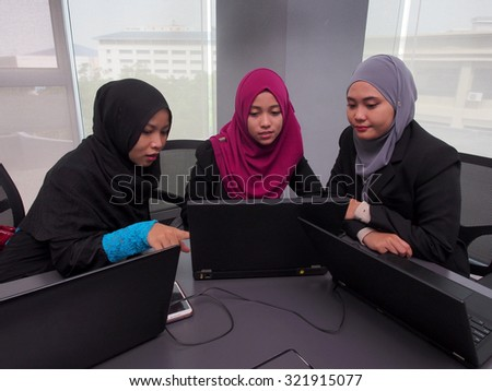 Three female business associates in a meeting. - stock photo