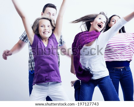 Three females and one male singing, dancing and performing. - stock photo