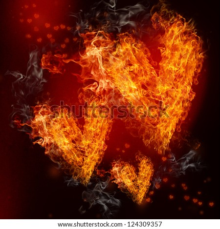 Three Fire Hearts on Black and Red Background - stock photo
