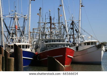 Three fishing trawlers tied to the moor at days end - stock photo