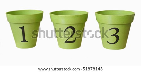 Three flower pots with numbers - stock photo