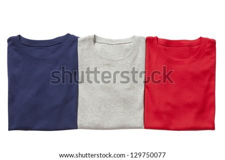 Three folded t-shirts isolated on white - stock photo