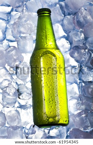 Three fresh beers with ice - stock photo
