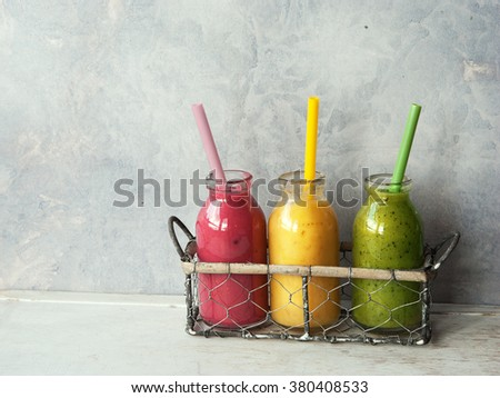Three fresh blended Fruit Smoothies in jar - stock photo