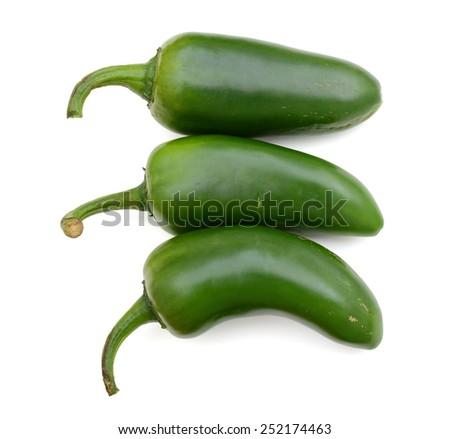 three fresh jalapeno peppers isolated on white - stock photo