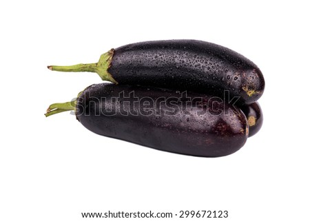 Three fresh raw eggplant with drops isolated on white background - stock photo
